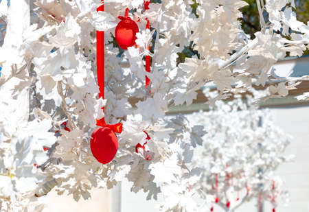 White trees and red hanging easter eggs for holiday streets decoration in Moscow, Russia 版權商用圖片