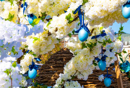 Blooming trees and blue hanging easter eggs for holiday streets decoration in Moscow, Russia Stock Photo