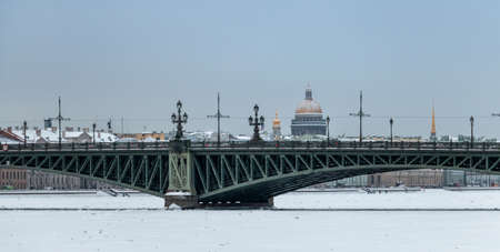 Winter panorama of Saint-Petersburg with Neva river, Isaac cathedral dome and Trinity bridge. Famous landmarks in Russia