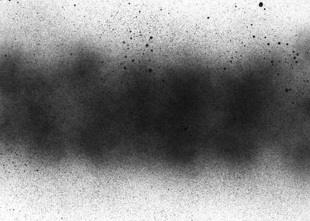 Subtle grit texture of black spray track on white paper. Particles and blots of paint