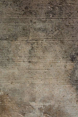 Concrete wall closeup photo. Speckled cement surface