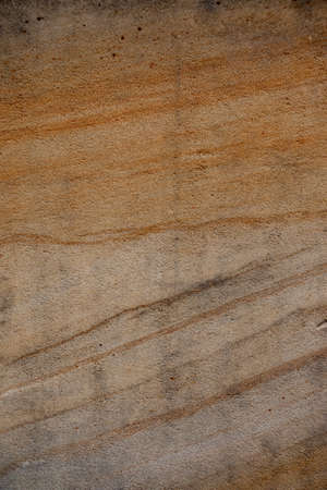 Brown sandstone wall texture details. Close-up photo of gritty background. Horizontal orientation Stock fotó