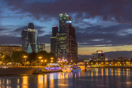 Moscow City business center and Moscow river at night