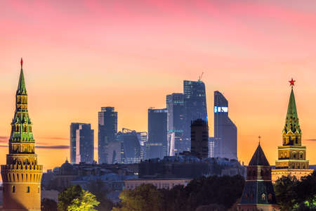Moscow city business center and Moscow Kremlin at colorful pink