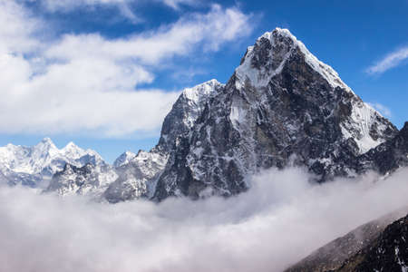 View of Cholatse peak. Blue sky with clouds. Himalayan mountains. Nepal. Stock Photo