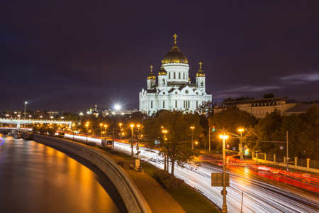 The Cathedral of Christ the Savior in Moscow , cars trails and Moscow river at night