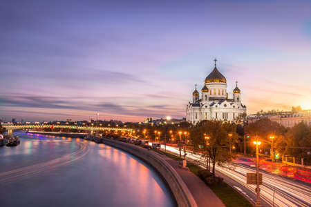 Cathedral of Christ the Savior, Moscow river and cars traffic at pink colorful sunset. Moscow, Russia