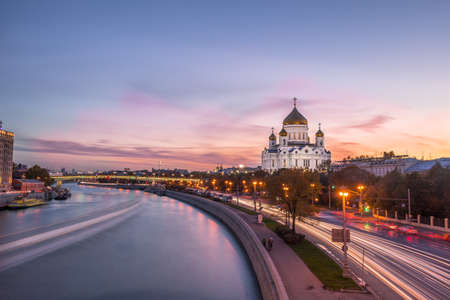 Cathedral of Christ the Savior, Patriarshy Bridge and traffic trails at sunset. Moscow, Russia