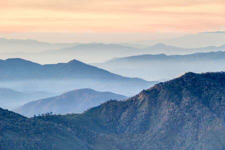 Layers of mountains on sunrise. Misty morning in Doi Inthanon, Thailand