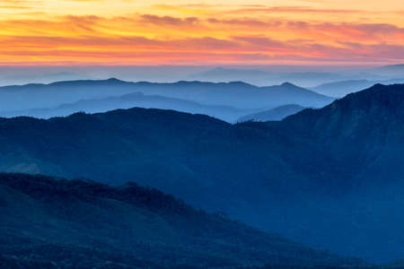 Mountains of Doi Inthanon national park and bright sunrise sky. Northern Thailand.