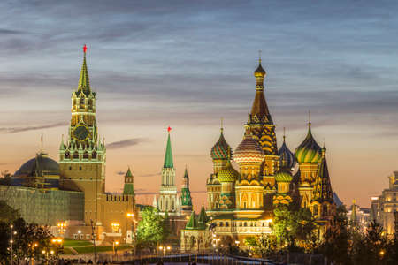 Illuminated Saint Basil Cathedral and Moscow Kremlin at sunset. Russia. Stock fotó
