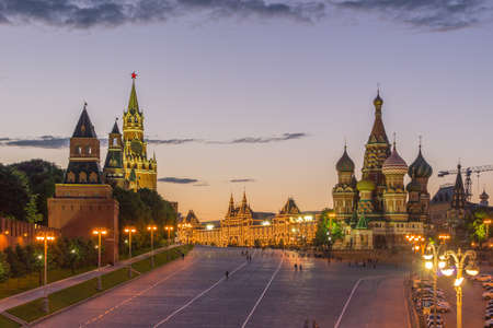 Illuminated Saint basil cathedral, moscow kremlin and red square in summer evening. Russia Stock fotó