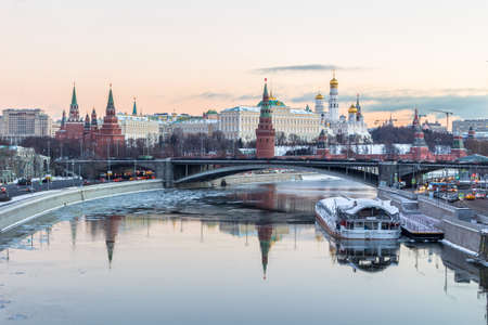 Moscow Kremlin, Moscow river and golden sky in cold snowy morning. Russia