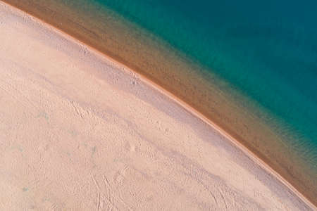White Sand Beach and Calm Turquoise Sea. Aerial Vertical Top-Down View Stock fotó