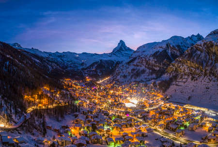 Zermatt Town and Matterhorn Mountain at Winter Night. Swiss Alps, Switzerland. Aerial View.