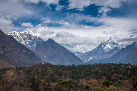 Ama Dablam and Taboche Mountains. Himalaya, Nepal. Blue Sky with Clouds Stock Photo