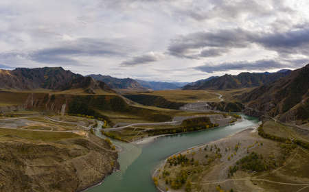 The confluence of Chuya and Katun rivers in Autumn. Green Hills and Mountains. Aerial View. The Altai Mountains, Russia