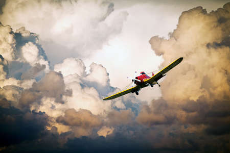training airplane in the clouds