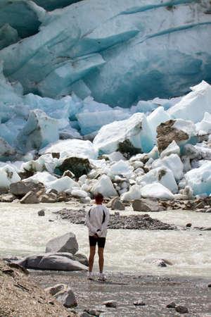 Alpine glacier in retreat - man watching Фото со стока - 134298357