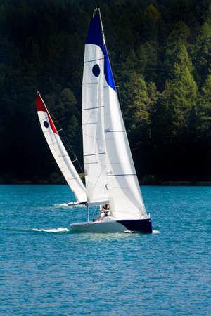 regatta in alpine lake - teamwork