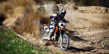 moto cross in action in dirt road