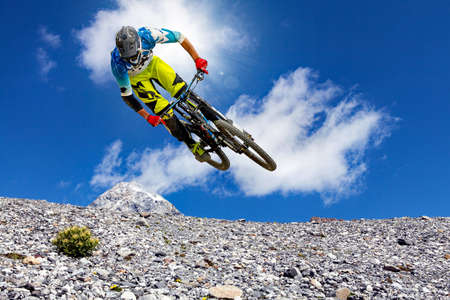 downhill biker in the high mountains