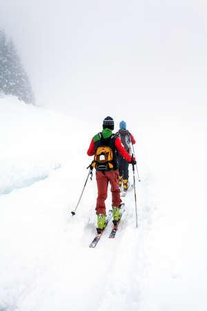 ski mountaineering excursion on a foggy day