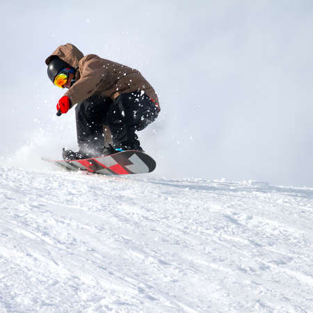 downhill with snowboards in fresh snow