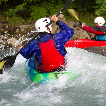 descent into rapids with kayaks