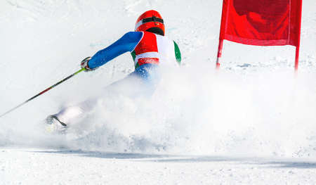 athlete engaged in giant slalom competition