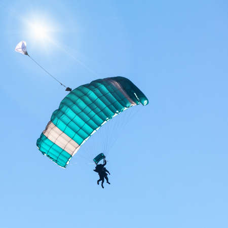 launch with tandem parachute in blue sky
