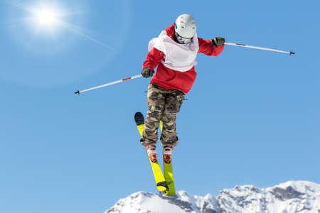 acrobatic jump on skis in winter scenery