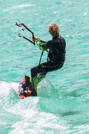 particular athlete with kite surfing