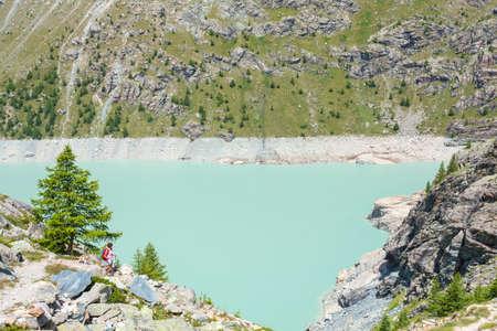 trekking on the Alpe Gera dam - Valmalenco (IT) 版權商用圖片