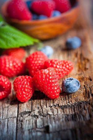 composition with blueberries and raspberries