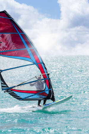 windsurfing in crystal clear sea