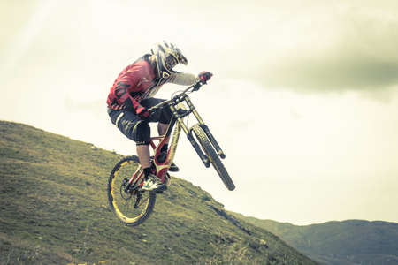 acrobatic jump with mtb on the moutains