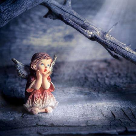 little angel sitting in meditation
