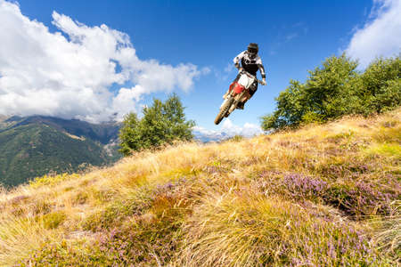 jump with a cross-country bike in the high mountains Reklamní fotografie