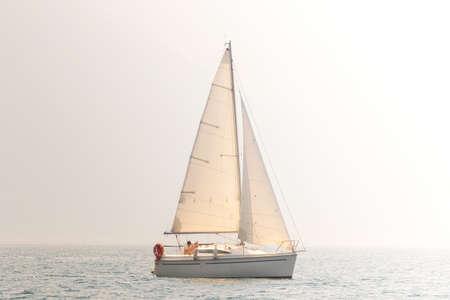 solo regatta with sailboat - vintage Stockfoto
