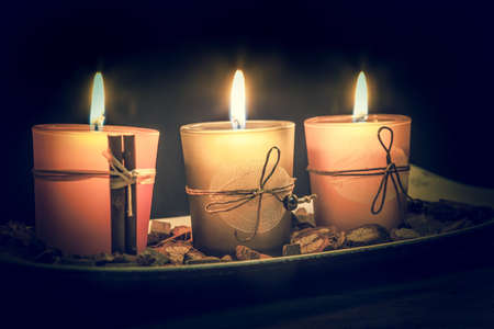 still life with three little candles