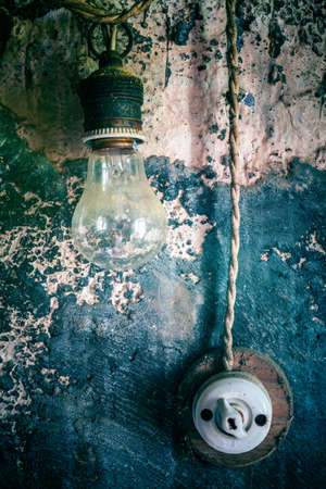 old ceramic switch with light bulb