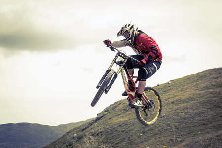 athlete engaged downhill with mtb Stock Photo