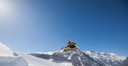 jump with snowmobile in fresh snow