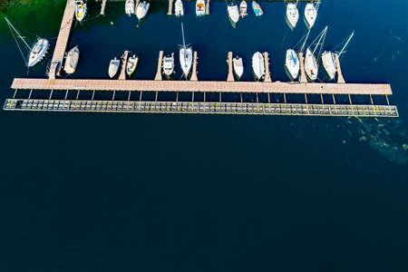 Moored sailboats and pleasure boats - aerial view Фото со стока