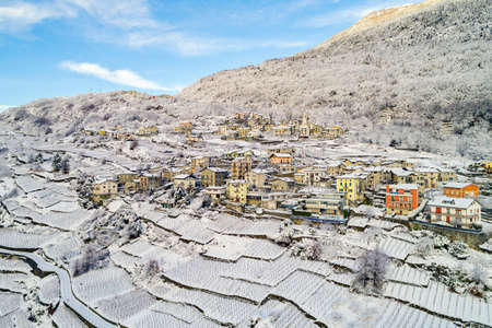 Valtellina (IT) - Panoramic winter aerial view of Sant 'Anna in Sondrio