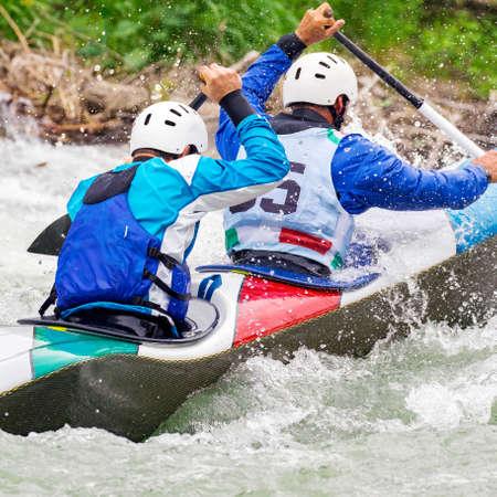 engaged athlete downhill with canoe