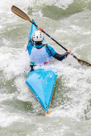 engaged athlete downhill with canoe