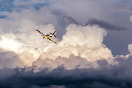 Airplane in the clouds in a stormy sky