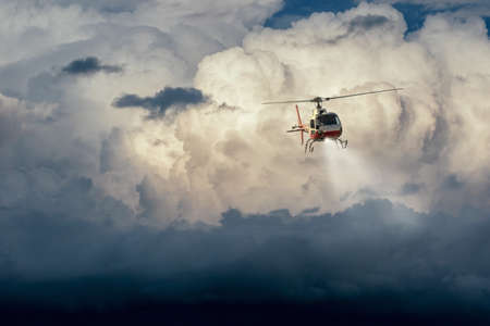 helicopter in flight in the cloudy sky